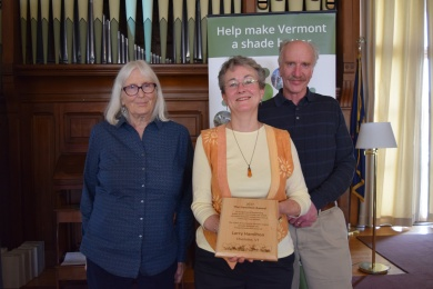 Mark with his deputy tree warden, Sue Smith (left) and Linda Hamilton, the widow of former tree warden Larry, accepting the inaugural Tree Warden Award at the 2017 VT Arbor Day Conference.